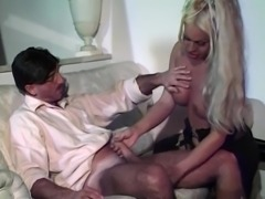 Longhaired blond tranny does her best for a businessman