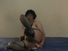 Mature Crossdresser breaks the ass with a sex toy