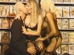 Hot threesome in porn shop