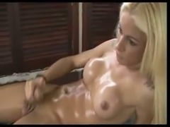 Sexy oiled up blonde tranny wanking