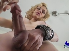 Blonde tranny jerking off her cock
