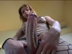 Blonde shemale in fishnet has a big dick