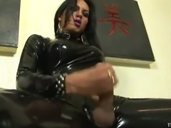 Hot babe in latex strokes yummy cock