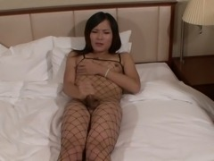 Japanese tranny in fishnet wanking