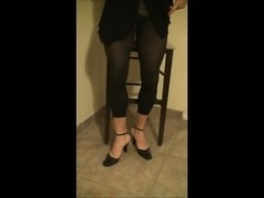 Crossdresser in Skirt Leggings and Heels Solo