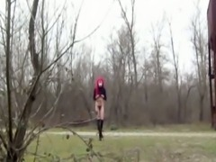 Young skinny crossdresser outdoor