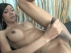 Hot Tgirl plugs her ass with toy