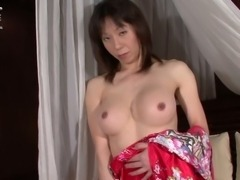 Asian TS milf shows her sweet ass