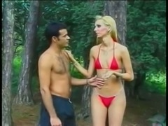 Blonde with small tits blows in the forest