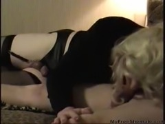 Crossdresser in black in homemade act