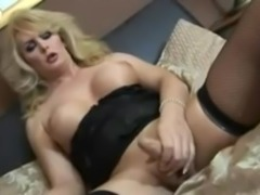 Busty blonde masturbates in black lingerie