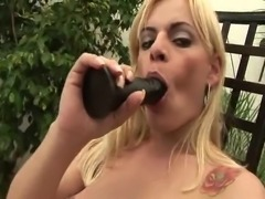 Lewd blonde with small tits plays with black dildo