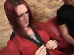 Redhead tattooed TS gets deep anal sex