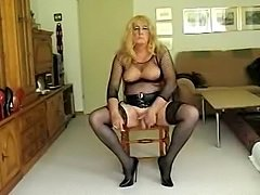 Crossdresser In Stockings Licks Dildo