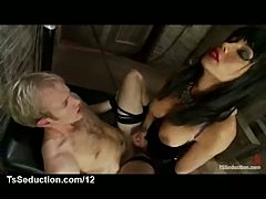 Busty asian tranny fucks a bound guy