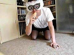 Solo Crossdresser In A Mask Sucking A Dildo