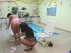 Two sexy ladies are fucking near the pool!