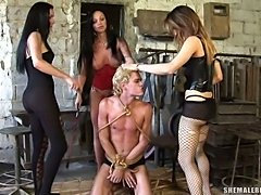 Assaultive bondage orgy with four trannys & pissing on guy