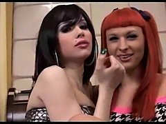 Brunette and redhead Tgirls hard fun