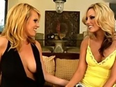 Two blonde babes begin undressing and kissing each other in fits of unbound lust